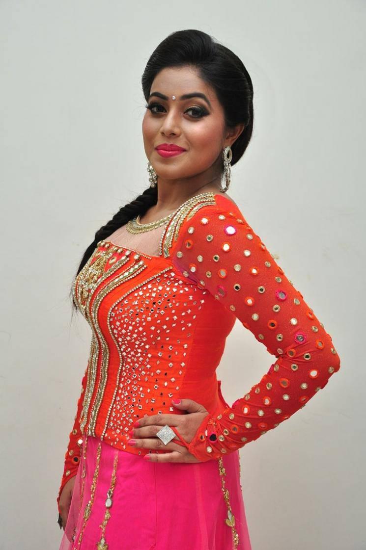 Hot South Indian Actress Poorna Long Hair Photos In Orange Dress At Audio Launch