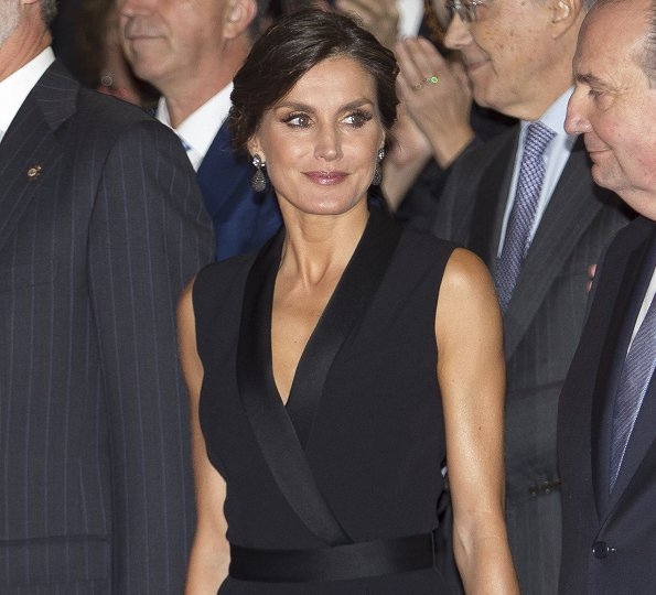 Queen Letizia wore HUGO BOSS V neck jumpsuit with satin trims. Magrit pumps, diamond earrings and baracelet