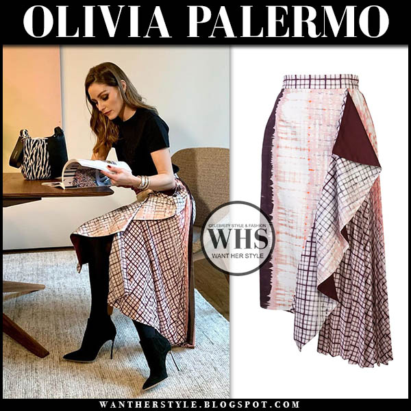 Olivia Palermo in purple plaid silvia tcherassi midi skirt and black top with black casadei blade booties. outfit december 16 instagram