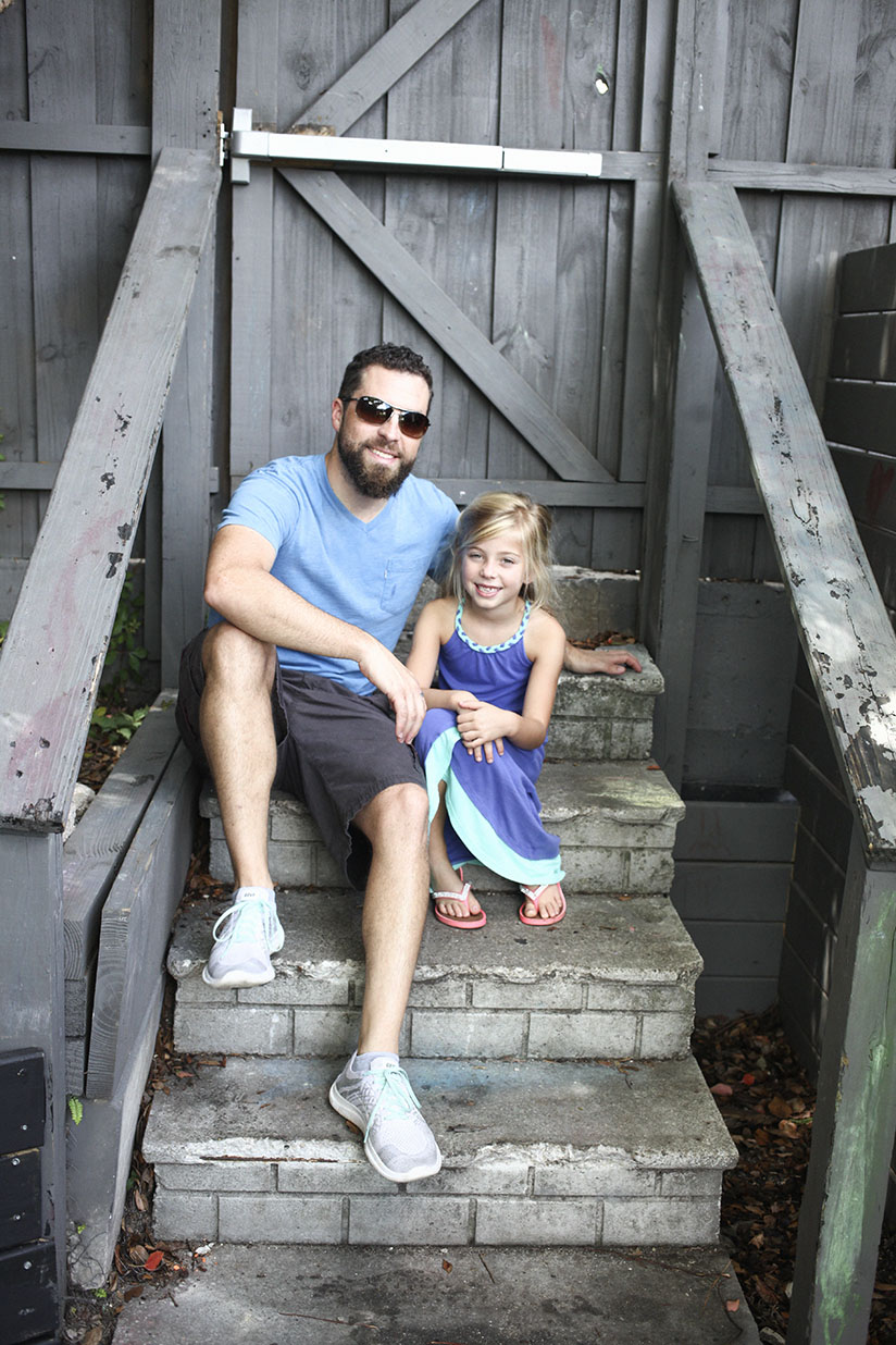 David West and daughter Sienna pose for the camera in The Bearded Pig's backyard