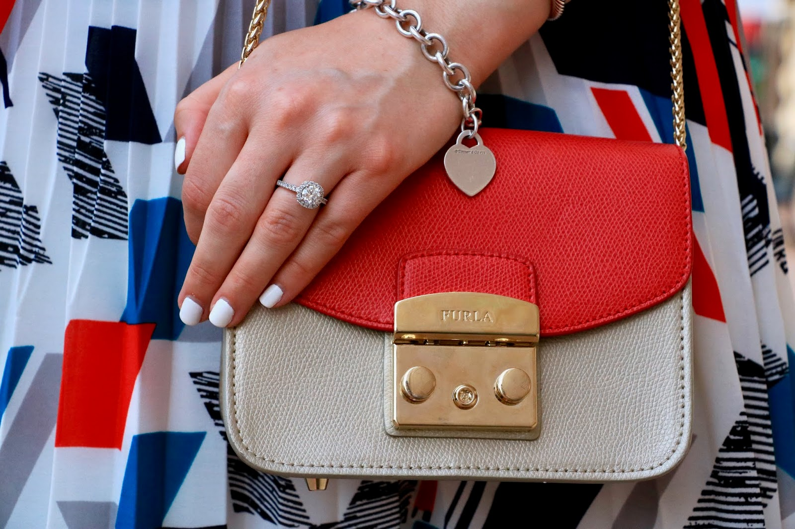 Nyc fashion blogger Kathleen Harper wearing a red Furla mini bag.