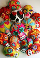 A collection of colorful Sugar Skulls on a white background.