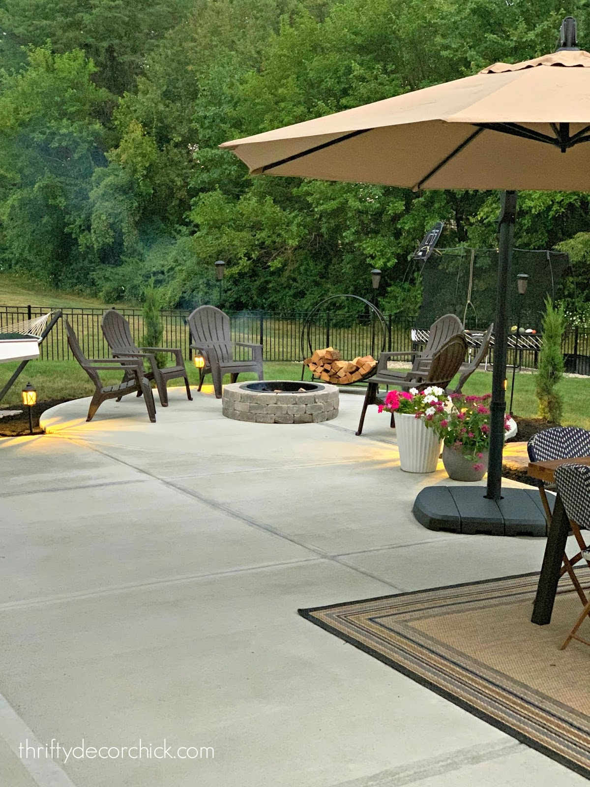Large patio with rounded fire pit area