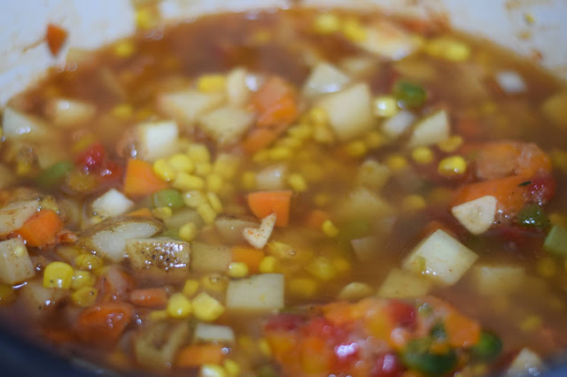 Vegetable broth being added to the chowder.