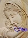 Relief bunda maria menggendong yesus