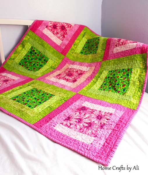 pink flowers and green I-Spy baby quilt