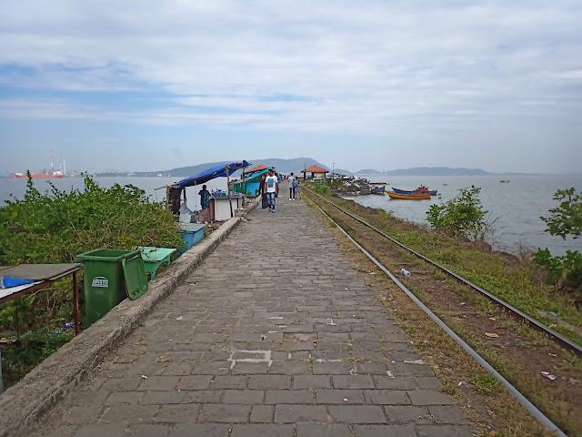 Ferry jetty with toy train tracks and walking path at Elephanta Island