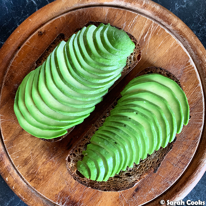 Sliced avocado on toast