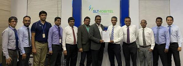 Participants at the handing over of agreement – (LTR) SLT . Waruna Gamage, General Manager, .Selvendiran Vidyapan, Deputy General Manager, Pandula Godakanda, Deputy General Manager, Mangala Samarajeewa, Chief Network Officer, Janaka Abeysinghe, Chief Enterprise and Wholesale Officer, Priyantha Fernandez, Chief Operating Officer, Kiththi Perera, Chief Executive Officer, and Shevan Goonetilleke, Director/Chief Executive Officer, MillenniumIT ESP, Dr. Sajeeva Narangoda, Director, MillenniumIT ESP, and Group VP, Ambeon Holdings PLC, Gerald Vethanayagam, Cisco Sri Lanka, Indika Premarathna, Head of Telecommunication Sector, MillenniumIT ESP, Ranga Kariyapperuma, Cisco Sri Lanka.
