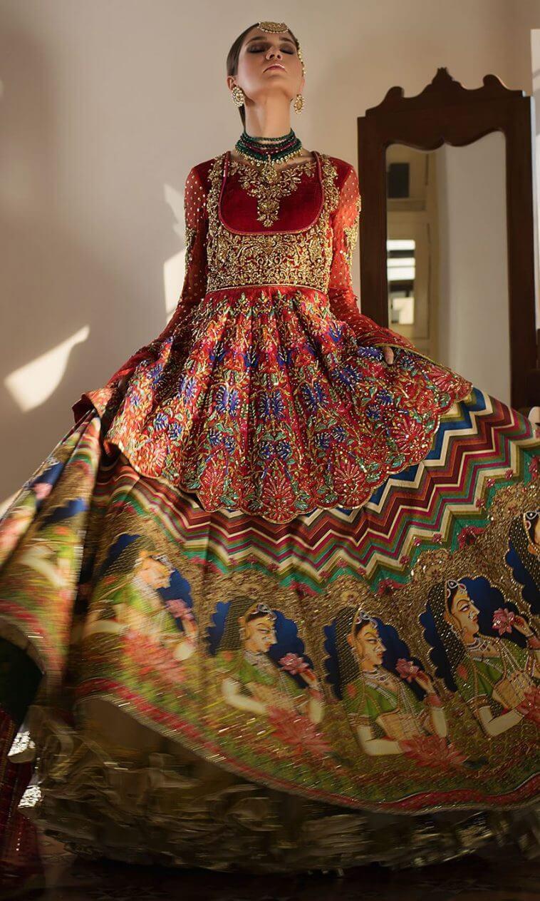 Bright red Pakistani bridal lehnga Mughal-e-azam by Nomi Ansari