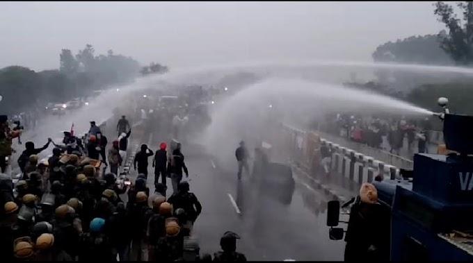 FarmersProtest- दिल्ली की तरफ कूच कर रहे किसानों पर कुरुक्षेत्र में पुलिस ने किया वाटर कैनन का प्रयोग, भीगते रहे.. आगे बढ़ते रहे किसान