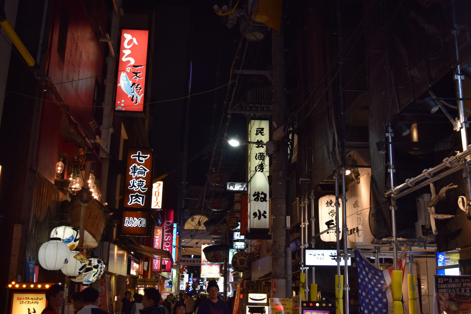 street signs, neon and crowds in Osaka at night