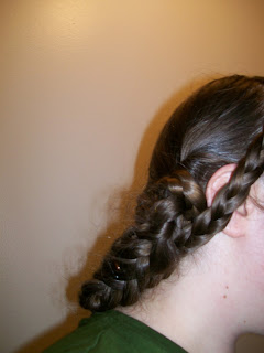 Back braids taken to the outside and crossed.