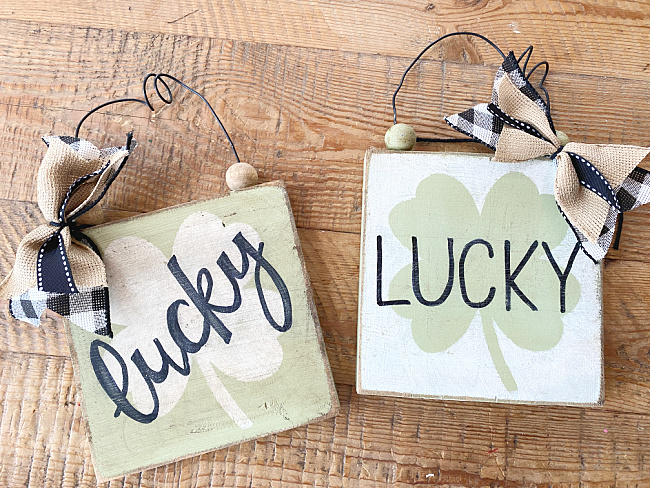 lucky signs with bows and wire hangers
