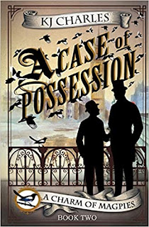 """Two men with hats, silhouetted in front of a short iron gate with a clocktower in the distance. Magpies fly around the the words """"A CASE OF POSSESSION"""" in large letters."""