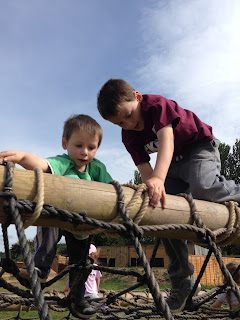 Two boys climbing over an obstacle at the Bear Trail, Cullompton.