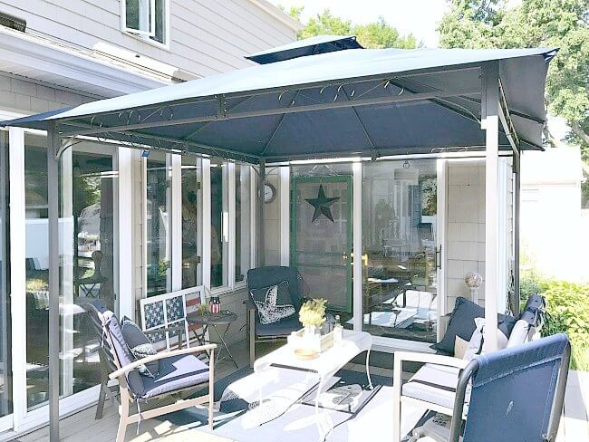 gazebo with navy blue outdoor furniture