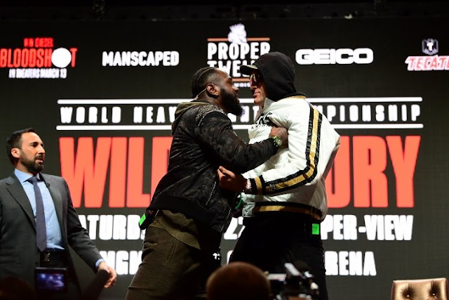 Tyson Fury Shoves Deontay Wilder
