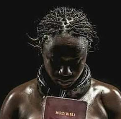 A Lady Poses Nude With Holy Bible For Photo-shoot