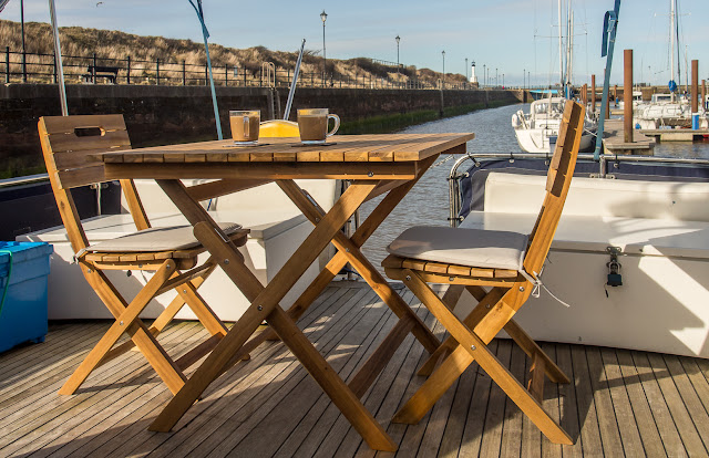 Photo of our table and chairs on Ravensdale's aft deck on a sunny day