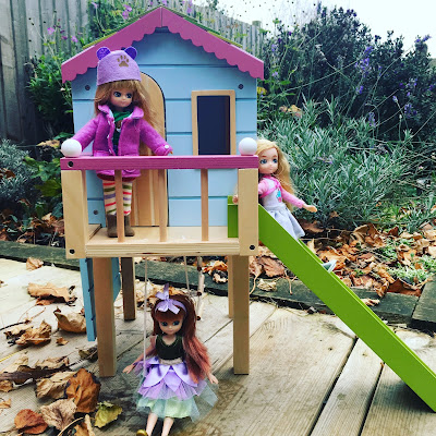 Lottie Dolls in their treehouse in the garden