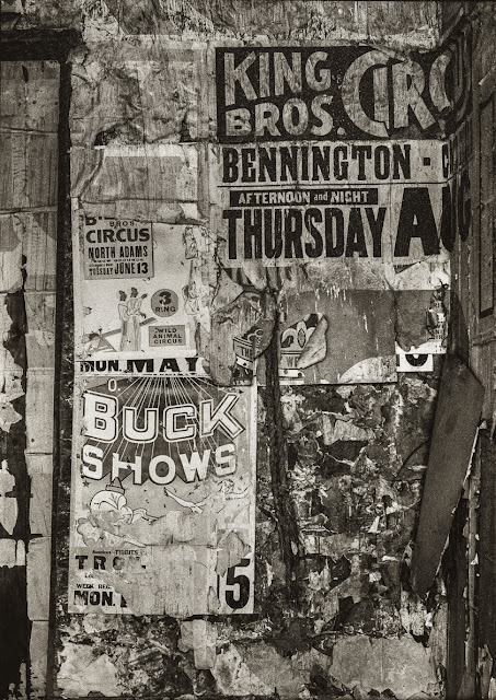 Layers of vintage circus posters. Buck Shows, Hoosac NY, June 1972