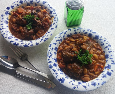 Braised Oxtail with Dry Tomatoes, Peppers, & Beans