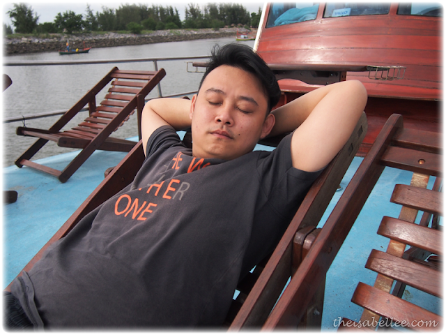Afternoon nap on top of the fishing boat