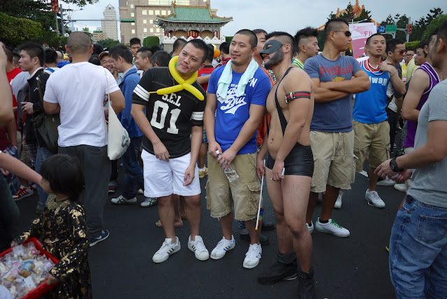 Young men being photographed at 2011 Taiwan LGBT Pride Parade