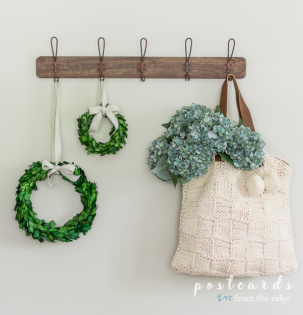 faux blue hydrangeas in a macrame tote bag with preserved boxwood wreaths