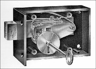 A black and white (lithograph?) image of a metal lock shown in cross-section with its internal workings on display, the metal key in the lock reads 'Chubb'.