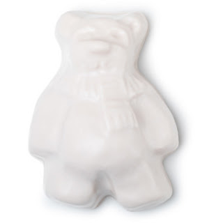 A bright white bear shaped soap on a bright background
