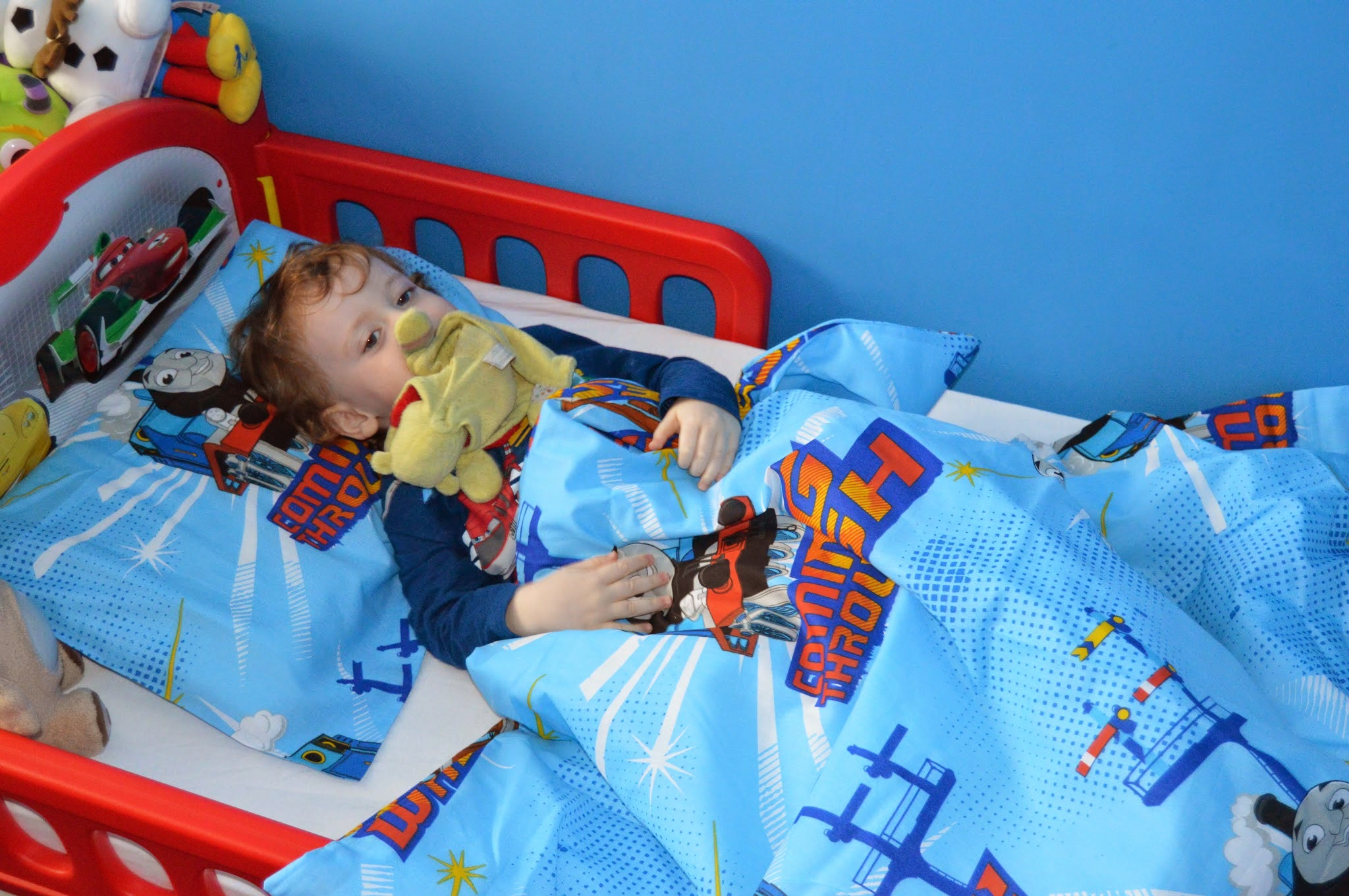 Toddler in his bed
