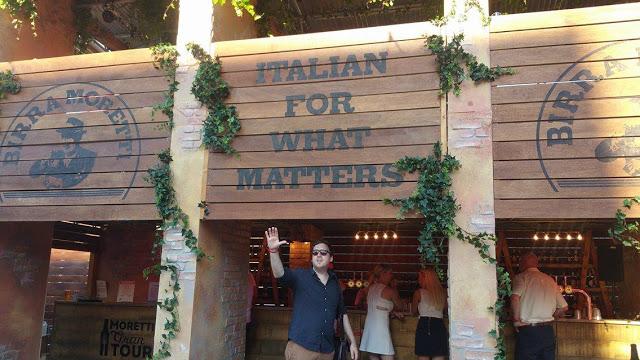 Boyfriend standing under Moretti stand