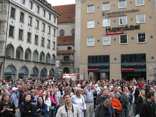 Large tourist crowds watch the Glockenspiel chime