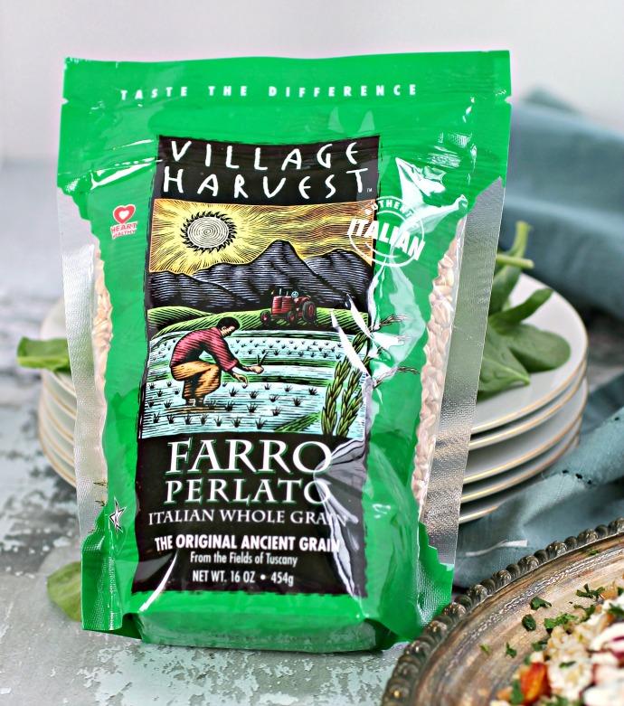 Recipe for a warm grain salad with farro, butternut squash, beets and a yogurt tahini dressing.