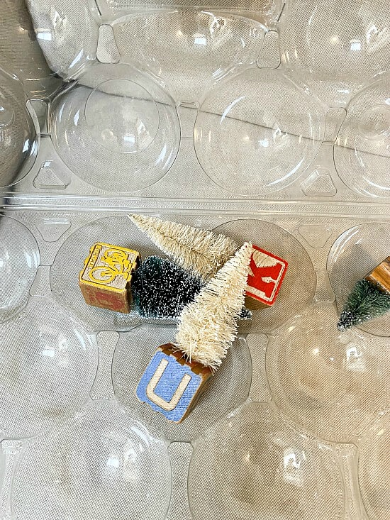 Apple container filled with small ornaments