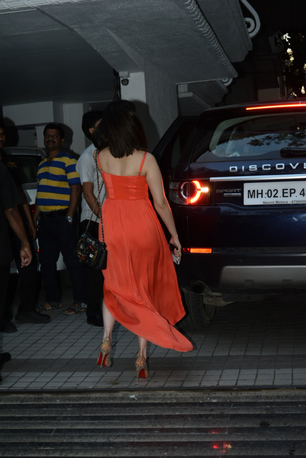 Tamannaah Bhatia in Orange Choffong Gown with Deep Neck at Juhu