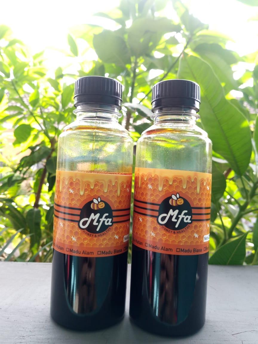madu hutan hitam asli