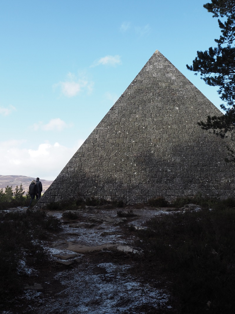 Two people next to Prince Albert's pyramid