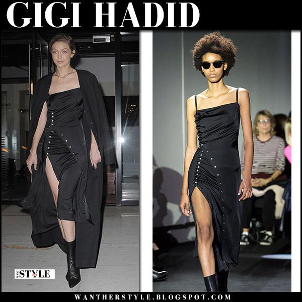 Gigi Hadid in black midi dress paco rabanne, black coat and black ankle boots at Aperture Gala red carpet october 30 2017
