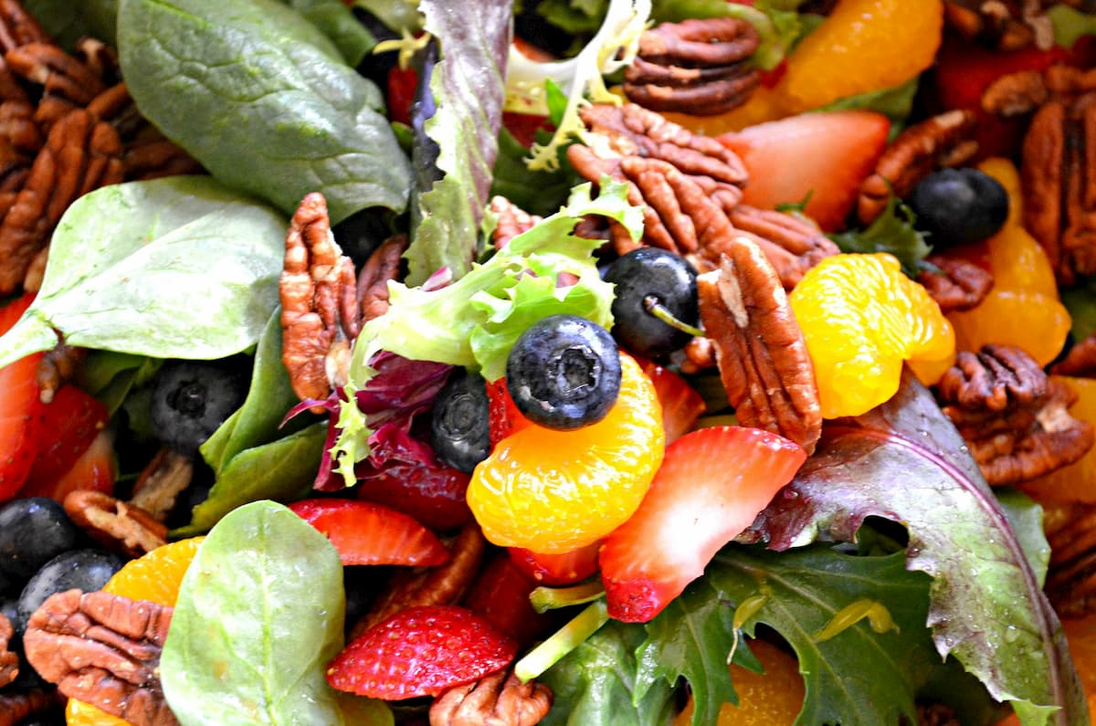 Baby Lettuce Greens tossed with sliced strawberries, blueberries, pecans and mandarin oranges.