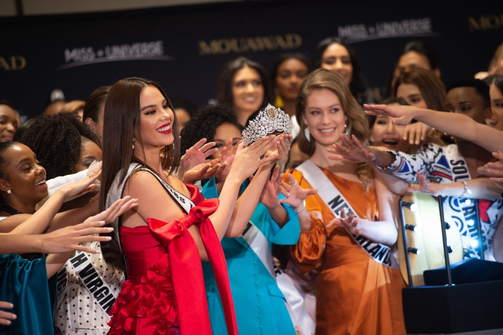 ATLANTA, GA - DECEMBER 5: Miss Universe Catriona Gray and Pascal Mouawad unveil the new Miss Universe crown on December 5, 2019 at Marriott Marquis in Atlanta, GA. Designed by luxury jeweler Mouawad, the crown is crafted in 18-karat gold, handset with more than 1770 diamonds including a magnificent centerpiece shield-cut golden canary diamond weighing 62.83-carats. The Power of Unity crown marks the first collaboration between Mouawad and Miss Universe. (Photo by Marcus Ingram/Getty Images for Endeavor)
