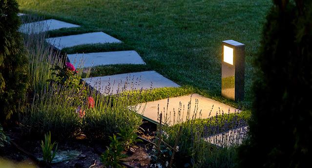 Lighted garden pathway with bollard lights.