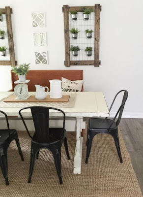Rustic white dining table and black chairs