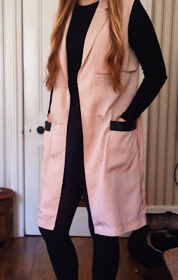 pink sleeveless coat