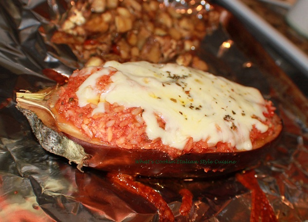 this is stuffed eggplant boats filled with cheese and meats