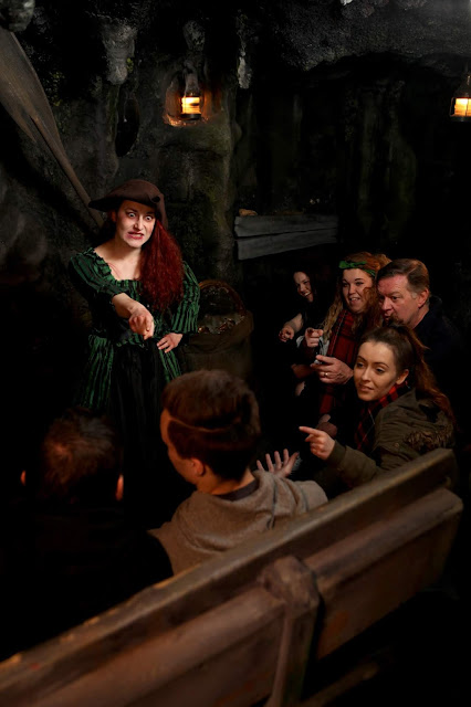 an actress dressed as a pirate pointing at a guest in The Dungeons
