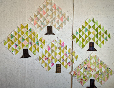 Tree blocks laid out with with pale pink and green fabrics call the colors of spring to mind