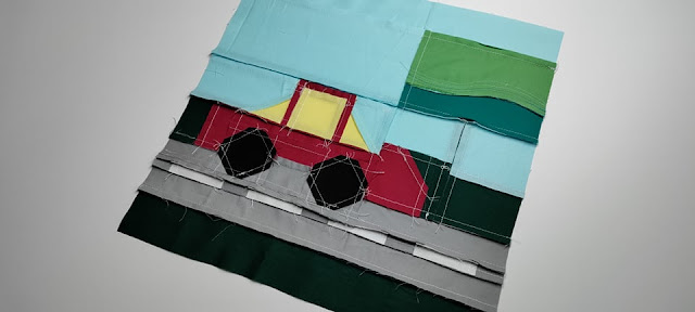 Road trip quilt block with car and billboard